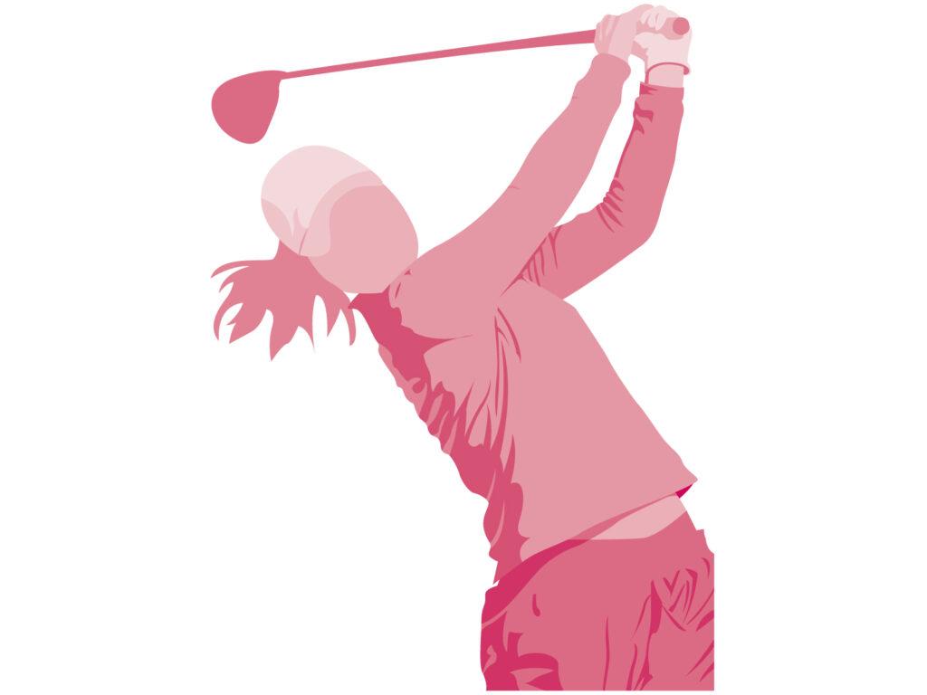 ドライバーショットを放つ女子ゴルファー